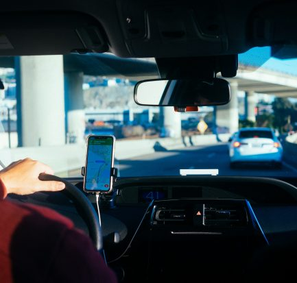 Gig worker driver following GPS to deliver food