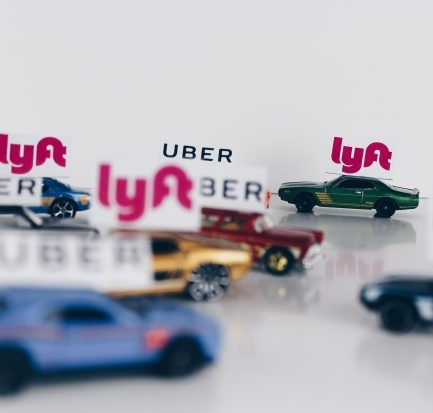 Toy cars with Lyft and Uber signs on them